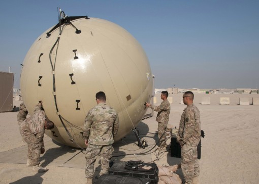Signal Soldiers of the 369th Sustainment Brigade practice aligning a Ground Antenna Transmit Receive (GATR) Ball at Camp Arifjan Kuwait on Jan. 10 2017. The GATR Ball is a portable satellite communications system that can be deployed to remote areas in a