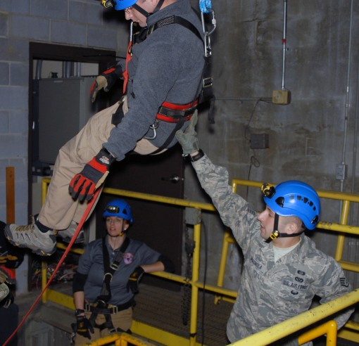 Staff Sgt. Joshua Spagnola of the New York National Guards 2nd Civil Support Team (right) guides New York State Police Contaminated Crime Scene Emergency Response Team (CCSERT) member Investigator Brian Kenney (left) as he descends via a complex rope syst