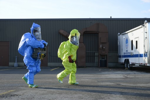 Tech. Sgt. Kenneth Beach( left)  assigned to the 174th Attack Wing and Airman 1st Class Danielle Garcia assigned to the 108th Wing make their way to a simulated chemical incident at Stewart Air National Guard Base Jan. 13 2017. The two emergency managemen
