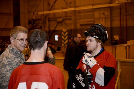 Col. Howard Wagner commander of the 105th Airlift Wing speaks with athletes during the Special Olympics of New York floor hockey tournament at Stewart Air National Guard Base Newburgh New York. Wagner later handed out medals and ribbons to the teams. This
