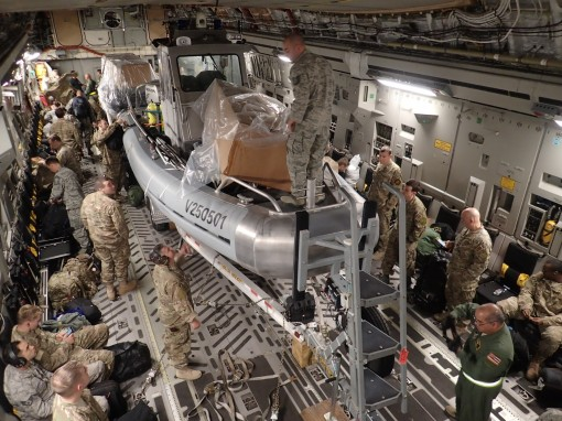 New York Air National Guard Airmen assigned to the 106th Rescue Wing  loading rescue boats onboard a C-17 at Gabreski Air National Guard Base on Feb. 27 2017 enroute to Hawaii where they will conduct training on systems designed by the Department of Defen