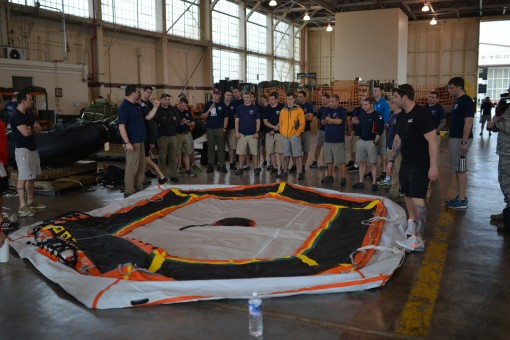 "Tim Goddard, from NASA's Neutral Buoyancy Laboratory, explains how to inflate the ""Front Porch"" floatation device for NASA's Orion spacecraft crew module to New York Air National Guard pararescuemen assigned to the 103rd Rescue Squadro"
