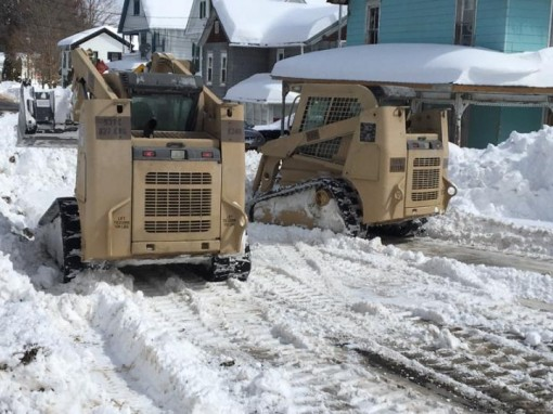 New York Army National Guard Soldiers assigned to the 827th Engineer Company clear snow from the streets of Deposit N.Y. on March 16 2017 as part of the New York National Guard response to the noreaster which dumped more than three feet of snow on the reg