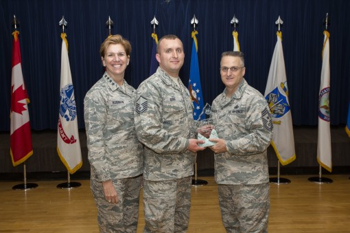 NORAD (North American Aerosapce Defense Command) Commander Lori Robinson and Chief Master Sgt. Harold Hutchinson right NORADs Senior Enlisted Leader present the NORAD Senior Noncomisioned Officer of the Year award to Master Sgt James Burke a member of the