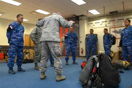 New York Air National Guard Command Chief Master Sgt. Michael Hewson the Command Chief of the 106th Rescue Wing demonstrates how the pararescuemen jump with a payload to the Indonesian air force generals March 8 2017 at Francis S. Gabreski Air National Gu