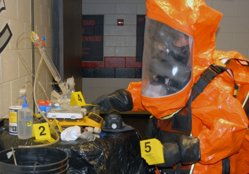 2nd Civil Support Team (CST) member Staff Sgt. Joshua Spagnola uses evidence markers to tag suspected hazardous materials in a mock WMD laboratory during the 2nd CSTs training exercise at Joseph L. Bruno Stadium in Troy N.Y. on April 12 2017. Team members
