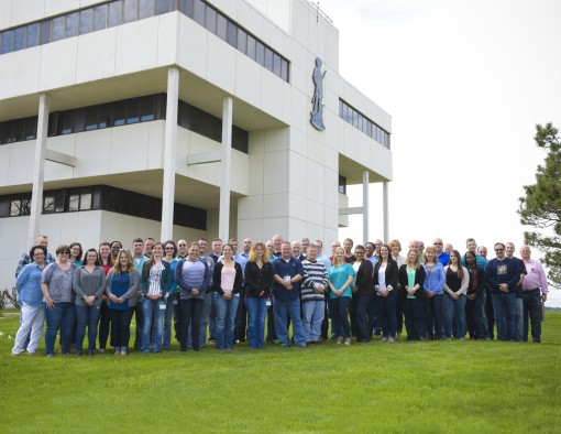 Members of the Division of Military and Naval Affairs headquarters staff pose for a photograph in support of Denim Day, a day on which people are encouraged to wear blue jeans to show support for survivors of sexual assault and to combat the myths surroun
