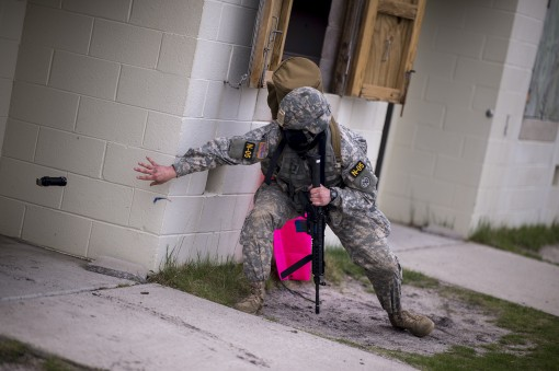 New York Army National Guard Sergeant Mitchell Stogel, a member of the 2nd Battalion 108th Infantry, tosses a flashbang into a room during a movement to contact training scenario at the Region One Best Warrior Competition on 26 April 2017  at Joint Base M