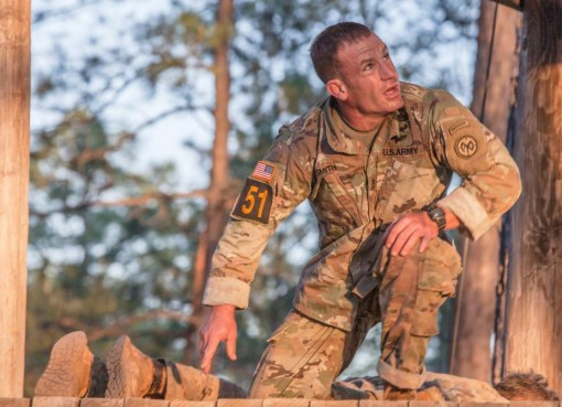 Sgt.1st Class Sean Smith a member of the 2nd Battalion 108th Infantry of the New York Army National Guard, negotiates the Darby Queen obstacle course during the 34th annual David E. Grange Jr. Best Ranger Competition at Ft. Benning Ga. April 9 2017.  Smit