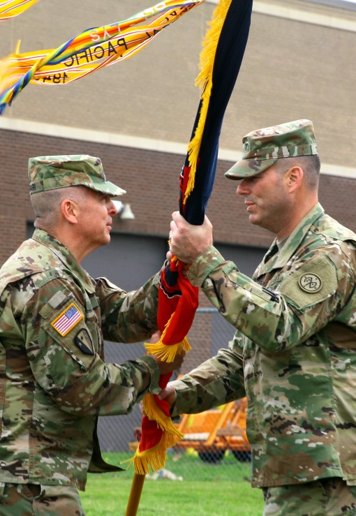 Brig. Gen. Steven Ferrari presents the 27th Infantry Brigade Combat Team's colors to Col. Christopher Cronin, the new 27th IBCT commander during a brigade change-of-command ceremony here May 21. Col. Cronin replaces the newly promoted Brig. Gen. Jose