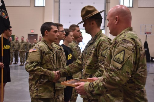 U.S. Army National Guard soldiers from Bravo Company Recruiting and Retention Command shake hands with their Drill Sergeant during a Battle Handoff Ceremony in the Queensbury Armory Queensbury N.Y. May 21 2017. Each soldier had reached the required amount