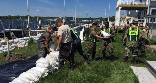 Reserve Sailors and Marines who are also members of the New York Naval Militia conduct sandbag operations at Sodus Point N.Y. on May 31 2017. Members of the New York National Guard and the New York Naval Militia which is also commanded by the Adjutant Gen