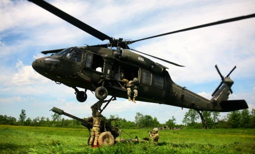 Soldiers assigned to Alpha Battery, 1st Battalion, 258th Field Artillery regiment, 27th Infantry Brigade Combat Team, prepares to attach a 105mm M119A2 Howitzer to UH-60 Blackhawk helicopter during a air assault artillery raid here June 9. The training m