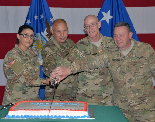 Youngest and oldest Soldiers present cut the birthday cake during Army Birthday ceremonies at New York National Guard Headquarters in Latham N.Y. on June 17 2017. Cutting the cake are from left PFC Jade Richards the youngest Solldier Brig. Gen. Raymond Sh
