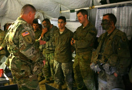 Brig. Gen. Joseph Biehler the 42nd Infantry Division deputy commander tours the  command post of the 1st Battalion 69th Infantry Regiment of the New York Army National Guard at Shoalwater Bay Queensland Australia during Combined Exercise Talisman Saber Ju