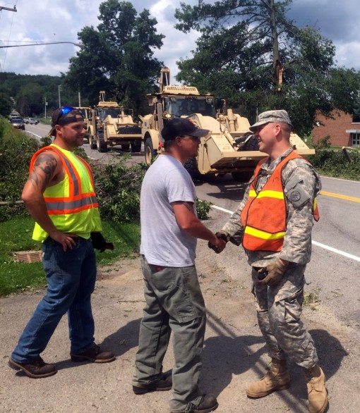 New York Army National Guard Sgt. Raymond Faltisco conducts initial linkup with Erie County Highway Department counterparts near Holland New York following tornado storm damage on July 20 2017. Faltisco from Buffalo New York joined other New York Army Nat