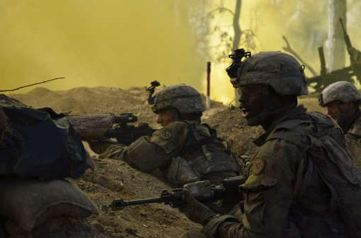 SHOALWATER BAY, Queensland, Australia--Soldiers from Charlie Company 1st Battalion 69 Infantry Regiment of the  New York Army National Guard acting as an opposing force defend their positions during the final battle of Exercise Talisman Saber at the Shoal