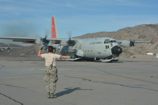 Staff Sgt. Kayla Ludivig, crew chief with the 109th Aircraft Maintenance Squadron, marshalls an LC-130 Skibird before it takes off for Raven Camp, Greenland, on July 27, 2017. The 109th AW is currently in its fifth rotation of the Greenland season which s