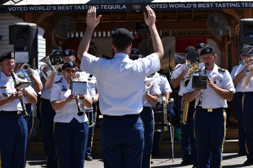 U.S. Army Soldier, Staff Sgt. Ethan Wagner, a member of the 42nd Infantry Division Band, conducts the band at the Saratoga Race Track