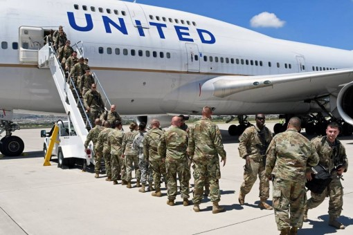 Soldiers of the New York Army National Guard's 1156th Engineer Company land at Fort Bliss, Texas on August 21,2017 after finishing a nine month deployment to Kuwait. The company, which specializes in building and repairing structures, supported U.S.