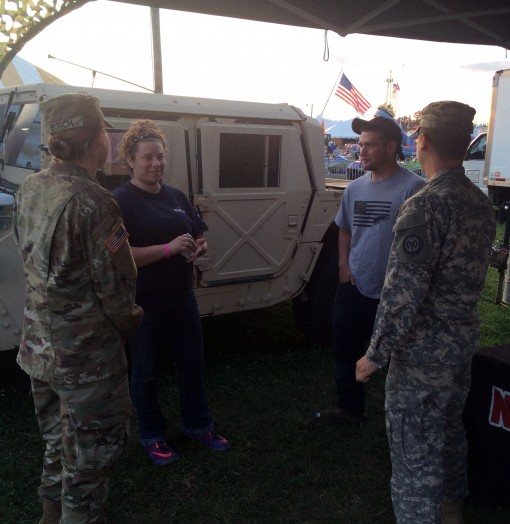 Army National Guard Soldiers, Spc. Bridgette Burch and Spc. Timothy Schwab, from Recruiting Command, speak with  fairgoers about the benefits of the National Guard at the Washington County Fair, Easton, N.Y., August 23, 2017.