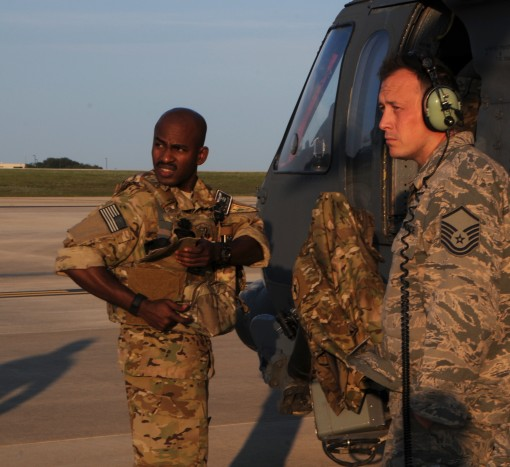 Air Force Capt. P.K. Osahor a pilot with the 101st Rescue Squadron of the 106th Rescue Wing assigned to the New York National Guard and Air Force Master Sgt. Sean Browning an HH-60 Pavehawk helicopter crew chief with the 106ths Aircraft Maintenance Squadr