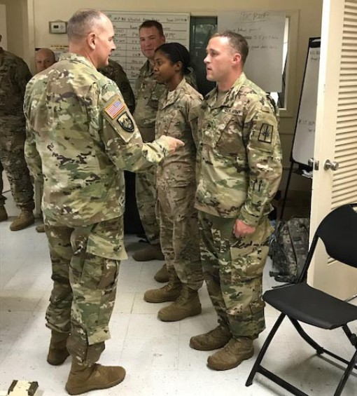 Lt. Gen. Timothy Kadavy the Director of the Army National Guard presents a coin to StaffSgt. Patrick Hahn a member of the New York Army National Guards 105th Military Police Company at U.S. Virgin Islands Joint Force Headquarters on St. Croix on Oct. 5 20