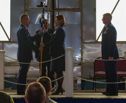 Col. Michele Kilgore, center, accepts the guidon of the 109th Airlift Wing from Major General Anthony German, the Adjutant General of New York and Commander of the New York Air National Guard, during change of command ceremonies on Sunday, Oct. 15, as Col