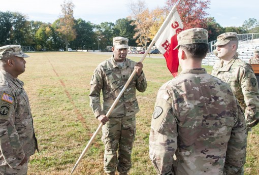 New York Army Nastional Guard Capt. Oyeyemi Daramola accepts the colors of  Headquarters Company of the 369th Sustainment Brigade during a change of command ceremony at Camp Smith NY  on October 22 2017. The unit returned this summer from a successful 9 m