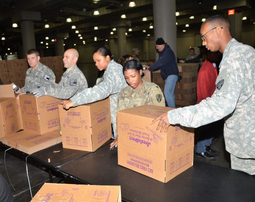 Volunteers from the New York NationalGuard and members of the New York Guard pack boxes with groceries for a Thanksgiving meal at the Jacob Javitts Center in New York on Nov. 20, 2017.