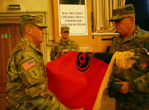 New York Army National Guard Col. Dennis Deeley the Joint Multinational Training Group - Ukraine commander and Command Sgt. Maj. Thomas Ciampolillo uncases the 27th Infantry Brigade Combat Teams colors during a JMTG-U Transfer of Authority ceremony here N