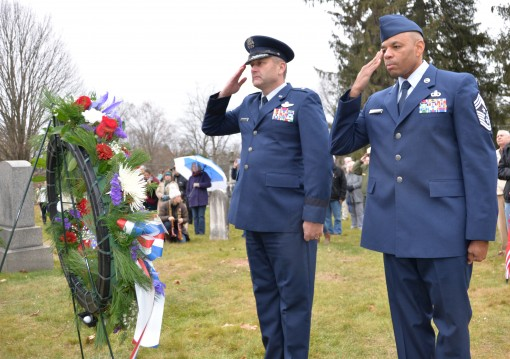 Brig. Gen. Timothy LaBarge the Chief of Staff for the New York Air National Guard and Command Chief Master Sgt. Denny Richardson of the 109th Airlift Wing salute during a ceremony honoring former President Martin Van Buren at his gravesite in Kinderhook N