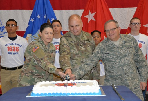 Maj. Gen. Raymond Shields commander of the New York Army National Guard (middle) joins Air National Guard Chief Master Sgt. Michael Blake age 58 the oldest  National Guard members present (right) and Army National Guard Spec. Jade Richards age 19 one of t