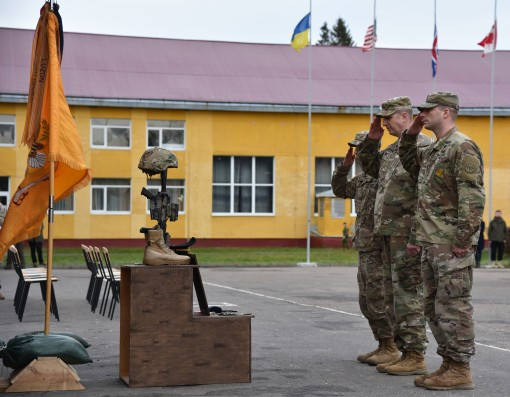 Leaders render honors during a memorial service honoring Specialist Joseph Nelk a New York Army National Guard Soldier who died of apparent natural causes while on Dec. 10 2017 while serving as part of the Joint Military Training Group- Ukraine at the Yav