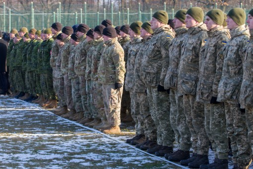 Soldiers assigned to the 27th Infantry Brigade Combat Team of the New York Army National Guard (center formation) join Canadian and Ukranian soldiers in listing to remarks from Canada's Governor General, Julie Payette, and Ukrainian President Petro P