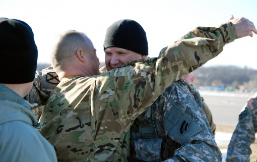 "A New York Army National Guard Soldier congratulates Chief Warrant Officer 5 Michael Johnson at Army Aviation Support Facility #3 in Latham, N.Y. on Jan. 25, 2018 following Johnson's ""Final Flight"" as an Army Pilot. Johnson celebrated his f"