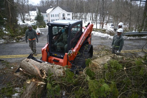 Airmen from the New York Air National Guards 105th Airlift Wing move debris from a road in the town of Carmel N.Y. on Monday March 5.Twenty Airmen assigned to the 105th Airlift Wing deployed to Putnam County New York to help town and county workers clear