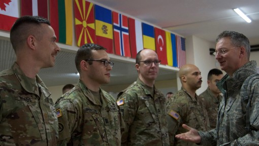 Maj. Gen. Anthony German  right the Adjutant General of New York meets with with officers of the New York Army National Guards 27th Infantry Brigade Combat Team at the Simulations Center assigned to the Joint Multinational Training Group - Ukraine. German