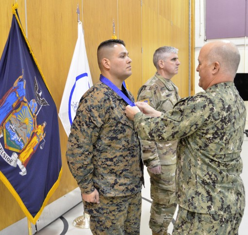 "New York Naval Militia Sergeant Christopher Vega receives the New York State Medal for Valor from  Naval Militia Rear Admiral Ten Eyck ""Trip"" Powell during a ceremony held at Camp Smith Training Site in Cortlandt Manor on Wednesday, March 14. Ve"