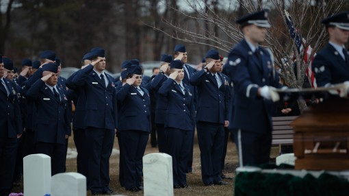 embers of the 106th Rescue Wing New York Air National Guard salute as Base Honor Guard Airmen from Joint Base McGuire-Dix-Lakehurst New Jersey render honors for Tech. Sgt. Dashan Briggs a special missions aviation specialist assigned to the 106th RQW duri