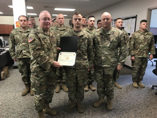 U.S. Army Soldier Michael Y. Tarkovsky an information technology specialist assigned to the 53rd Digital Liaison Detachment New York Army National Guard is promoted to the rank of private first class in a ceremony at Camp Smith N.Y. March 4  2018.