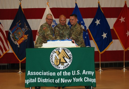 The Youngest and oldest Soldiers present cut the birthday cake during an Army birthday ceremony at the New York National Guard Headquarters in Latham N.Y. on June 14 2018. Cutting the cake are from left Sgt. Tyler Center the youngest Soldier Maj. Gen. Ray