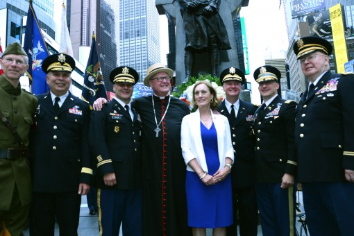 Cardinal Timothy Dolan, the Archbishop of New York (center with star hat) and World War I Commission  director Libby O'Connell join Army National Guard leaders at the statue of  Father Francis P. Duffy, the chaplain of the 69th Infantry during World