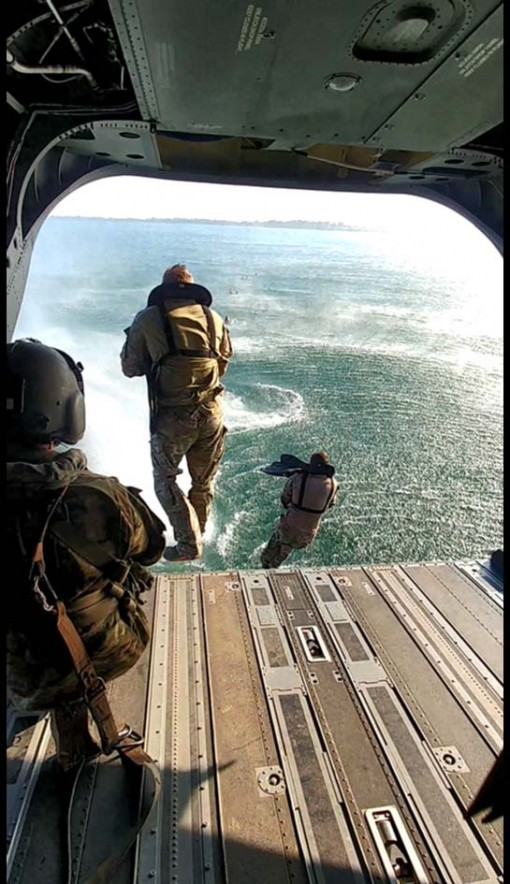 -A member of the West Virigina Army National Guard's 2nd Battalion 19th Special Forces Group ( Airborne) exits a CH-47 Chinook helicopter assigned to the New York Army National Guard's Bravo Company, 3rd Battalion 126th Aviation,  over Lake Erie