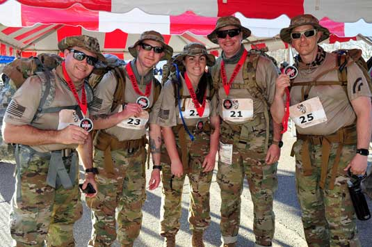 New York Army National Guard Soldiers assigned to the 3rd Battalion 142nd Aviation pose for a photo after completing the Bataan Memorial Death March at White Sands Missile Range on March 17, The team completed the grueling 26.2 mile ruck march through the