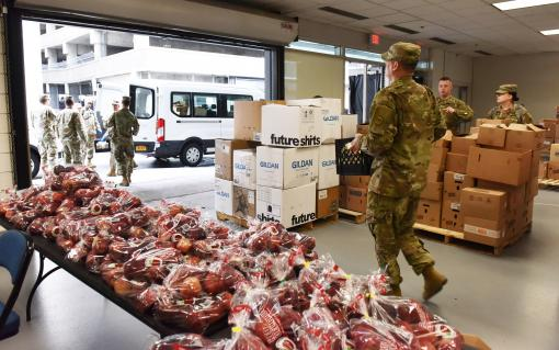 Soldiers distributing food in Albany County