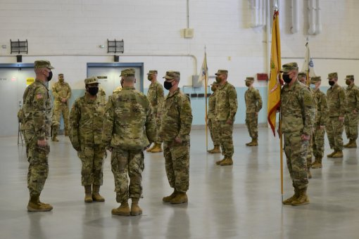 New York Army National Guard Command Sgt. Major Debora Mallet, prepares to assume the duties of command sergeant major of the 642nd Aviation Support Battalion from Command Sgt. Major Robert Ravert, during a change of responsibility ceremony conducted at t