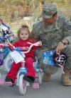 Soldier and Daughter Enjoy New Bike