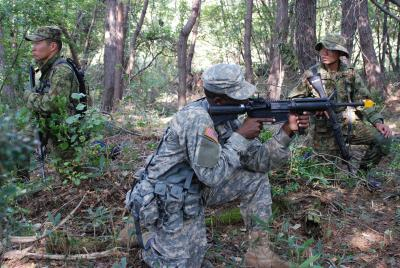 Army Scouts Walk Same Path: U.S., Japanese Discover that No Matter the Uniform, the Mission is the Same